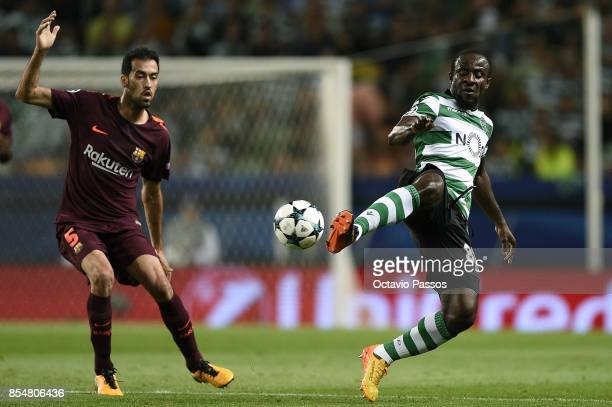 Seydou Doumbia of Sporting CP competes for the ball with Sergio Busquets of FC Barcelona during the UEFA Champions League group D match between...