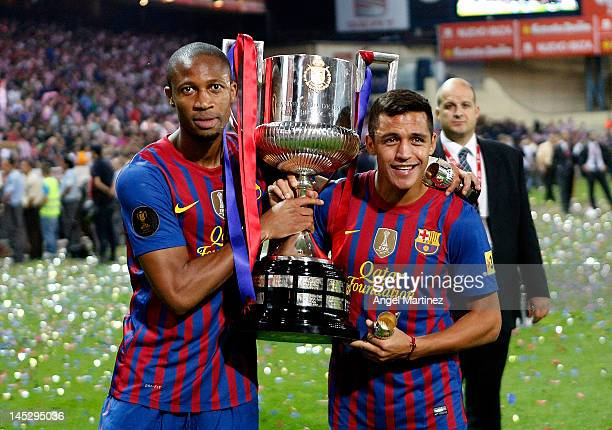Seydou Keita and Alexis Sanchez hold the trophy after their victory in the Copa del Rey Final match between Athletic Bilbao and Barcelona at Vicente...