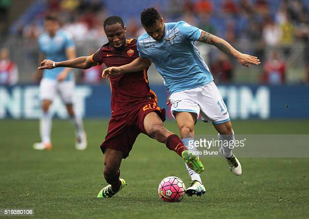 Seydou Keita of AS Roma and Felipe Anderson of SS Lazio compete for the ball during the Serie A match between SS Lazio and AS Roma at Stadio Olimpico...