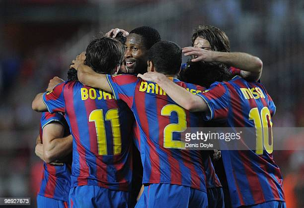 Seydou Keita of Barcelona players celebrates with teammates after Barcelona scored their 3rd goal during the La Liga match between Sevilla and...