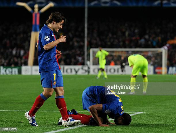 Seydou Keita of Barcelona sits on his knees celebrates scoring flanked by his teammate Bojan Krkic during the UEFA Champions League First knockout...