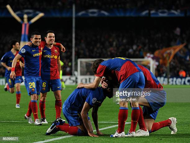 Seydou Keita of Barcelona sits on his knees celebrates scoring during the UEFA Champions League First knockout round second leg match between...
