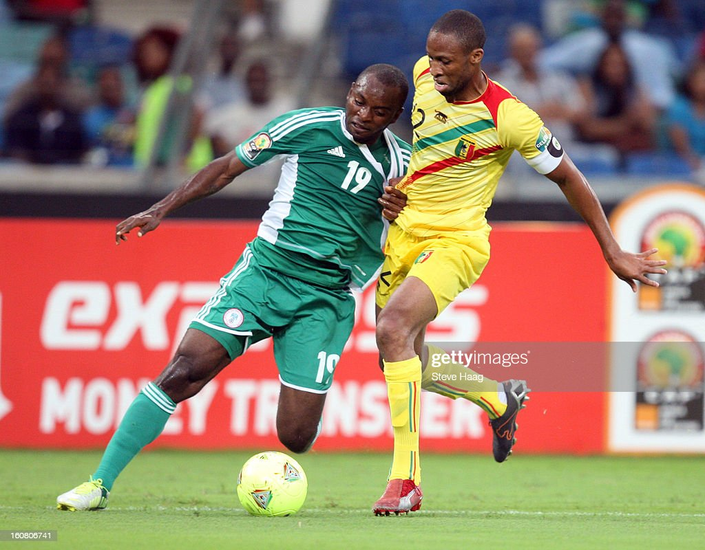 Seydou Keita of Mali with tackles Sunday Mba of Nigeria during the 2013 African Cup of Nations Semi-Final match between Mali and Nigeria at Moses Mahbida Stadium on February 06, 2013 in Durban, South Africa.
