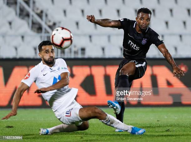 Seydouba Soumah of Partizan scores a goal against Henry Swenson Wingo of Molde during the UEFA Europa League Play Off First Leg match between...