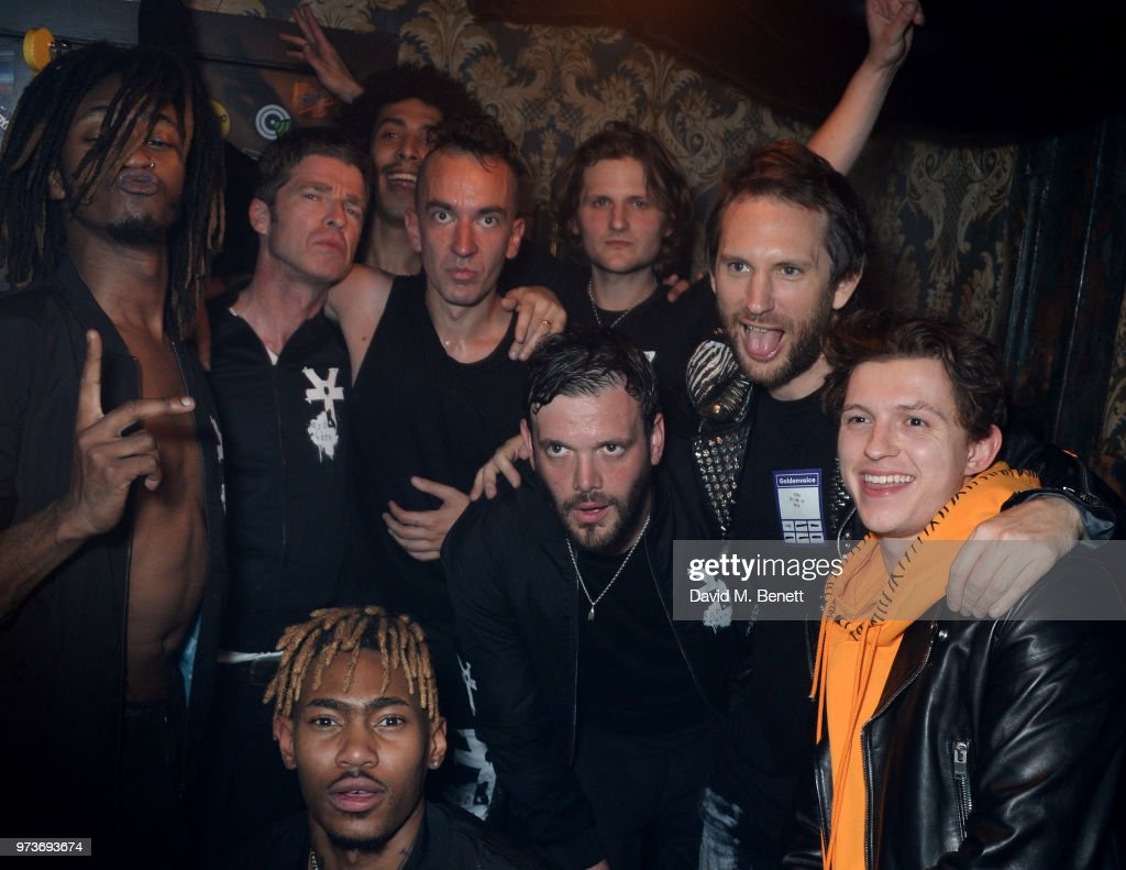 Seye Adelekan, Noel Gallagher, Twiggy Garcia, Young Lazarus, Jeff Wootton, Jamie Reynolds, Jay Sharrock, Marc Jacques Burton and Tom Holland pose backstage following YOTA's performance at XOYO on June 13, 2018 in London, England.