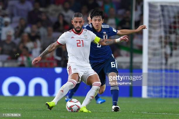 Seyed Ashkan Dejagah compertes for the ball against Wataru Endo of Japan during the AFC Asian Cup semi final match between Iran and Japan at Hazza...