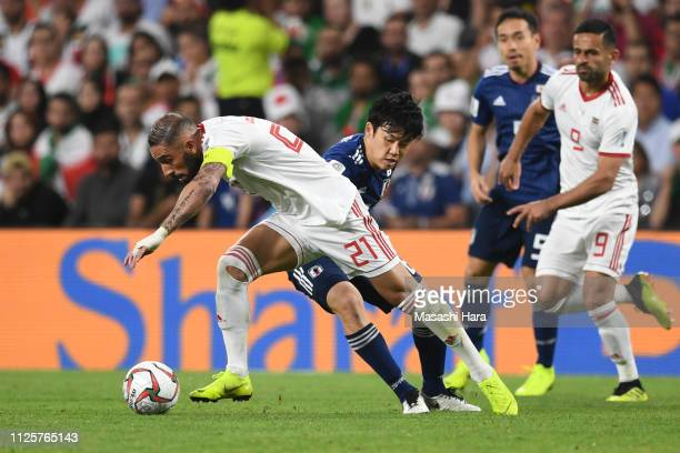 Seyed Ashkan Dejagah of Iran and Wataru Endo of Japan compete for the ball during the AFC Asian Cup semi final match between Iran and Japan at Hazza...
