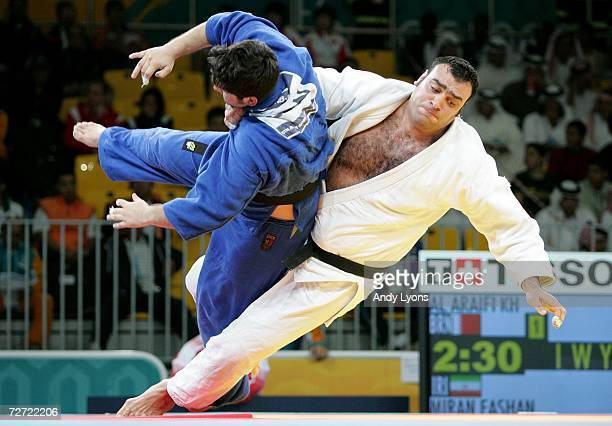 Seyed Mahmoudreza Miran Fashandi of the Islamic Republic of Iran flips Khaled Nabeel Al Araifi of Bahrain during the Men's Open Judo Competition...