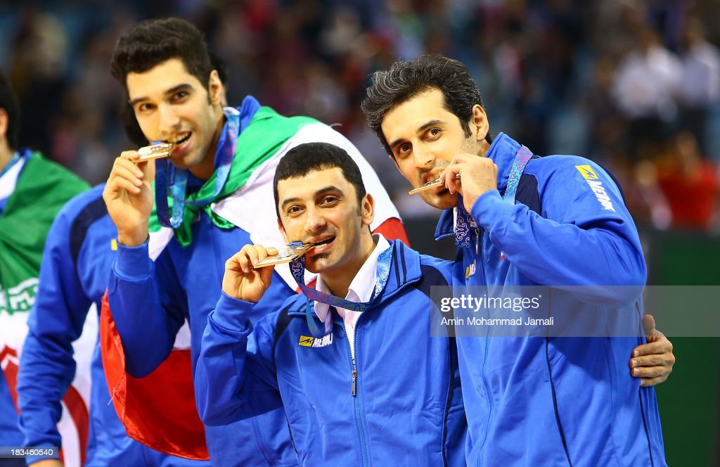 Seyed mohammad Mousavi (L) and Farhad Zarif and Mir Saeed Marouf during 17th Asian Men's Volleyball Championship between Iran And Korea on October 6, 2013 in Dubai, United Arab Emirates.