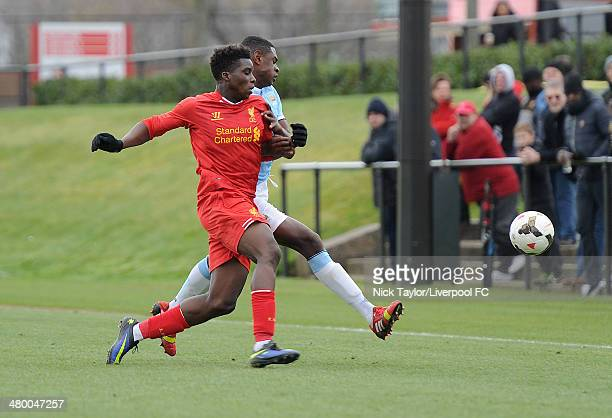 Seyi Ojo of Liverpool and Nathaniaz Oseni of Manchester City in action during the Barclays Premier League Under 18 fixture between Liverpool and...