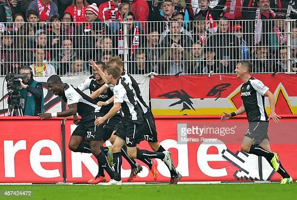 Seyi Olajengbesi, Jim-Patrick Mueller, Florian Huebner and Rene Gartler of SV Sandhausen celebrate after scoring the 0:1 during the game between 1 FC...
