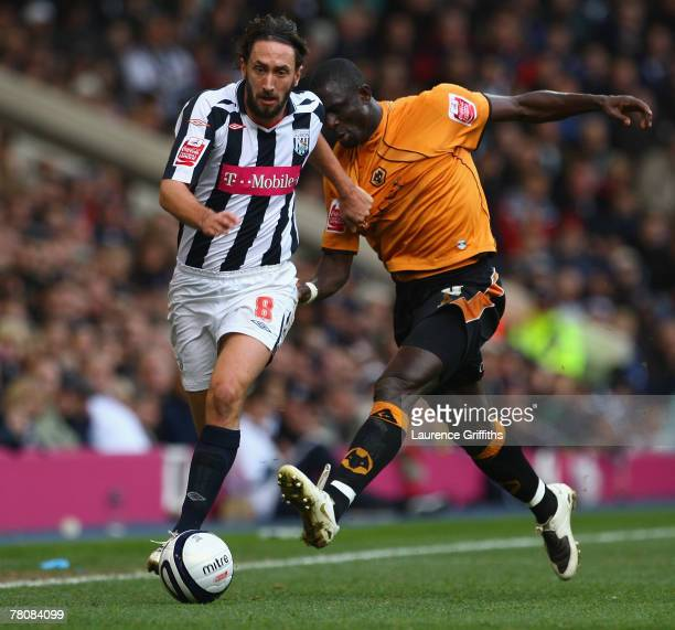 Seyi Olofinjana of Wolves battles with Jonathan Greening of West Bromwich Albion during the Coca Cola Championship match between West Bromwich Albion...