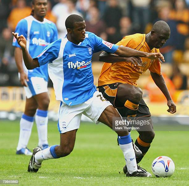 Seyi Olofinjana of Wolves tangles with Fabrice Muamba of Birmingham City during the Coca Cola Championship match between Wolverhampton Wanderers and...