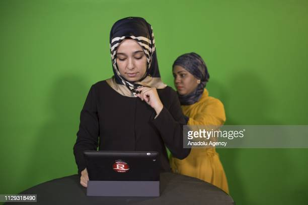 Seyma a Turkish student and a volunteer anchor for the English news program prepares on set prior to the recording session at Rohingya Vision TV...