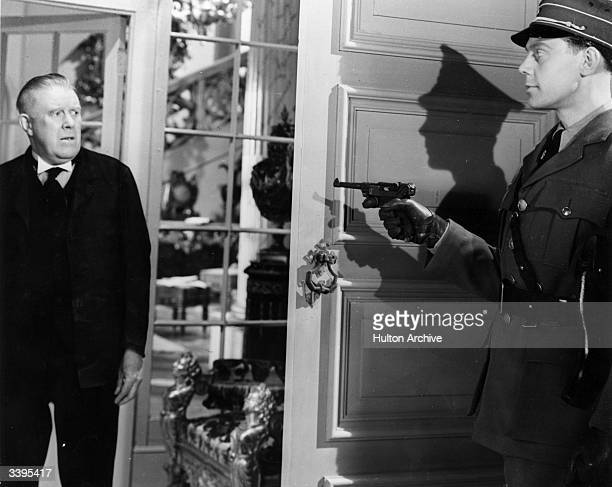 Seymour Hicks and Marius Goring in a scene from the film 'Pastor Hall', directed by Roy Boulting for Charter Films.