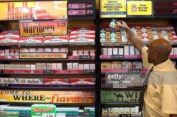 Seyum Yrhannes takes a pack of cigarettes bundled with a free sample of Snus a new smokeless tobacco by Philip Morris sold under the Marlboro name at...