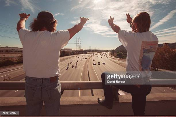 SFBikers#4db11–10 Haley Davidson enthusiasts wave and signal to the thousands of bikers that crossed below this Glendale overpass during the 13th...