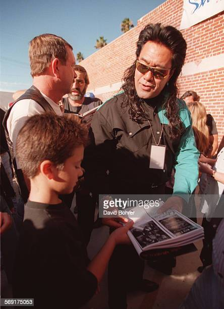 SFBikers#5db11–10 Actor Branscombe Richmond of the TV adventure series 'Renegade' signs an autograph for a young fan at the 13th Annual Love Ride...