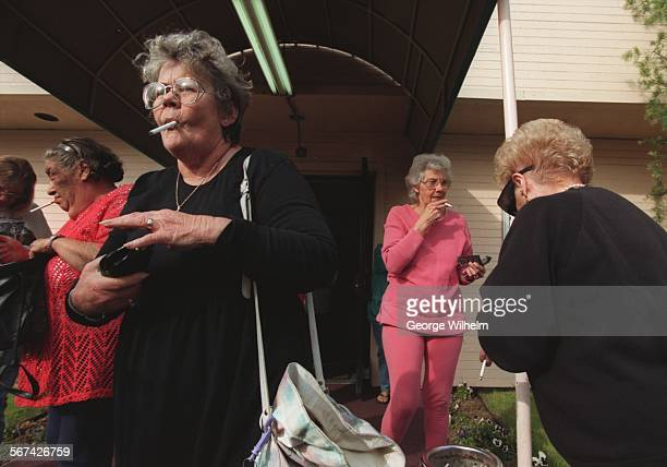 SFBingo10129GW1/28/98 – Ladies who play Bingo at the Fully Alive Center in Mission Hills congregate outside during a 5 minute 'smoking break' Players...
