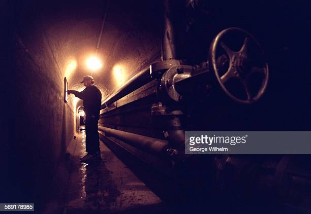 SFDam10203GW2/3/98 – Sepulveda Dam damkeeper Dave Manring is deep in the bowels of the dam where he checks a chart while making sure the spilway...