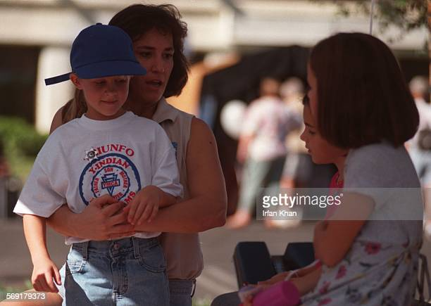 Fair.2.1102.IK ; Agoura Hills, Nov. 02Children watch Dr. Jon Mitchell perform Heimlich maneuver on Brianne Hazlewood at Disater Preparation Fair at...