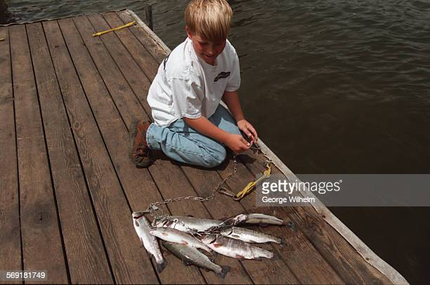 SFFreshwater4GW5–30–97Boy with a stringer of trout caught at Gull Lake in the Eastern Sierra recently