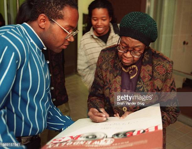 SFPoet1bv4–16/VALENCIA –– Pulitzer Prize winning poet Gwendolyn Brooks right signs posters for fans at Cal Arts Wednesday evening following her...