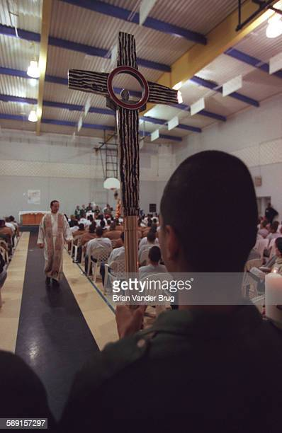 SFService4bv12–24/LANCASTER –– A young offender serving as an alter boy prepares to lead Cardinal Roger Mahony and his entourage at Challenger...