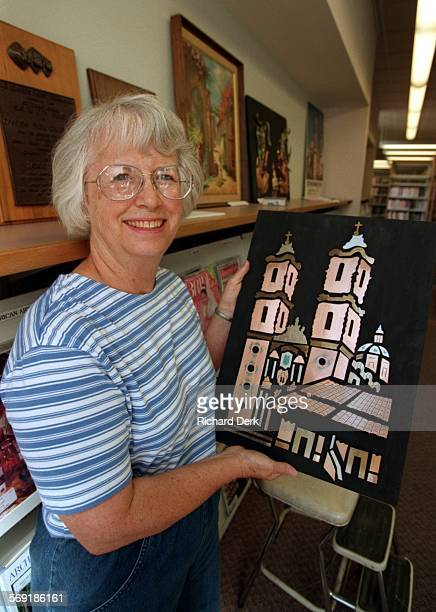 Taxco.2.Rd.7–31–97 Woodland Hills: Platt Branch Library: Jane Stauss of Friends of Taxco–Taxco is the West Valley's Sister City in Mexico–positions...