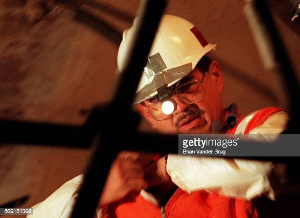 SFTunnel4bv1–22/NEWHALL PASS – Metropolitan Water District Lake Matthews Construction Services worker Allan Schlobohm toils by headlight inside the...