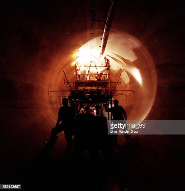 SFTunnel5bv1–22/NEWHALL PASS – Metropolitan Water District Lake Matthews Construction Services worker toil on scaffolding set up 160 feet below...