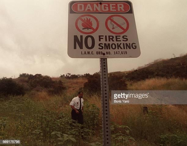 SFWeeds20611BY Walking thru waist high mustard weed and rye grass in Woodland Hills is LA City Fir e Inspector Michael Woods This hillside is near...