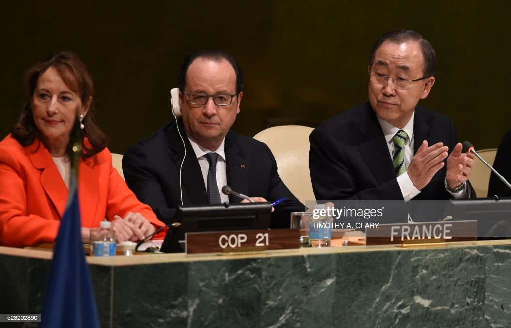 Ségolène Royal, Francois Hollande, President of France, and UN Secretary General Ban Ki-moon,attend the high level signature ceremony for the Paris Agreement at the United Nations General Assembly Hall April 22, 2016 in New York. World leaders are gathering at the United Nations to sign the Paris climate deal on combatting global warming, a first step towards ensuring they uphold their promises to cut greenhouse gas emissions. / AFP PHOTO / TIMOTHY A. CLARY / The erroneous mention[s] appearing in the metadata of this photo by TIMOTHY A. CLARY has been modified in AFP systems in the following manner: [Ségolène Royal) instead of [Princess Lalla Salma of Morocco]. Please immediately remove the erroneous mention[s] from all your online services and delete it (them) from your servers. If you have been authorized by AFP to distribute it (them) to third parties, please ensure that the same actions are carried out by them. Failure to promptly comply with these instructions will entail liability on your part for any continued or post notification usage. Therefore we thank you very much for all your attention and prompt action. We are sorry for the inconvenience this notification may cause and remain at your disposal for any further information you may require.