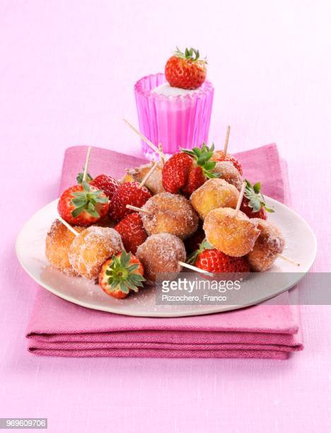 sgonfiotti di ricotta (deep-fried ricotta bites, italy) - balls deep stock photos and pictures