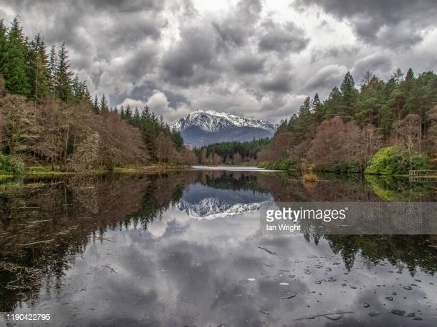sgorr a'choise reflected in one of the glencoe lochans - moment of silence stock pictures, royalty-free photos & images