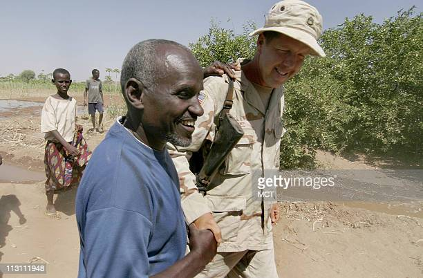 Sgt 1st Class Adam Reed from Sidon Mississippi is greeted by a Somali farmer in Sankabar Ethiopia January 17 2006 A small US military task force in...