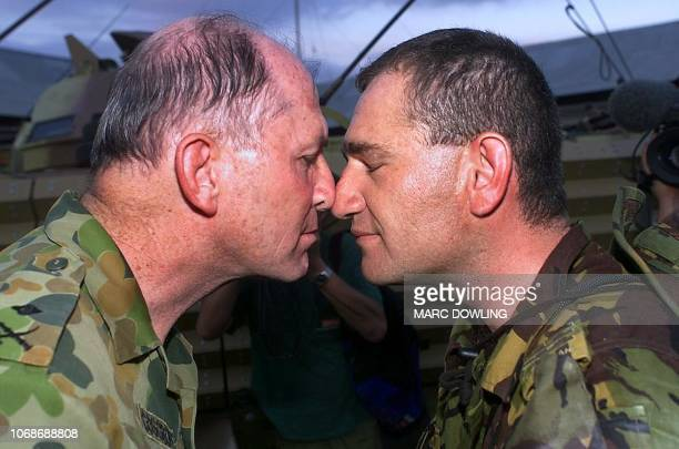 Sgt Aaron Morrison of First Battalion Royal New Zealand infantry regiment greets INTERFET General Peter Cosgove with a hongi a traditional Maori...