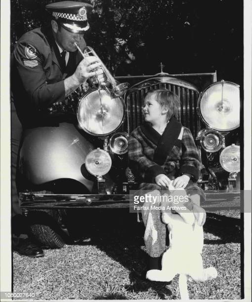 Sgt Alf Edwards of the NSW Police Band plays a tune on his trumpet for 6 yr old Robin from the Royal Alexandra Hospital for Children during today's...