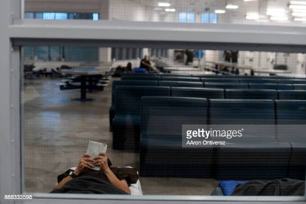 Sgt An inmate reads on his 'boat' bed on the floor in the new wing of the Pueblo County Detention Center on Wednesday December 6 2017 The jail which...