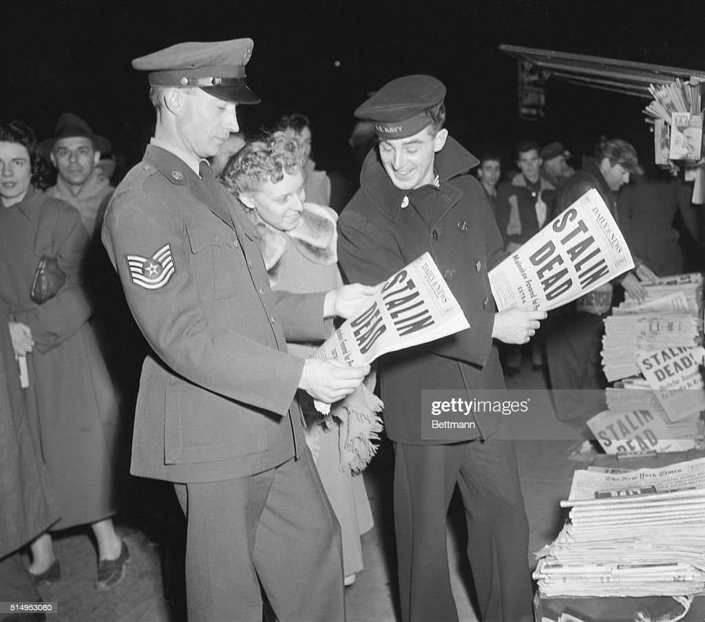 Sgt. and Mrs. Dennyson Webb (left) and PN3/C George Hodil, Jr. read the headlines announcing the death of Josef Stalin, March 5th, at a newsstand in Times Square. The leader of world communism for over 30 years died within the the thick-walled Kremlin. His heart 'stopped beating,' the Moscow radio announced.