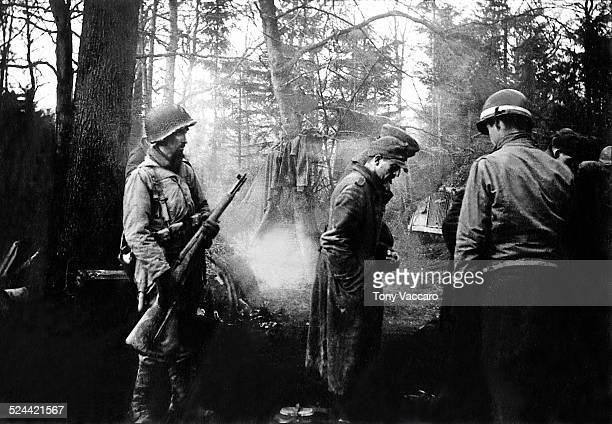 US Sgt Cayne seen here with German POWs Battle of the Bulge Hürtgen Forest Germany World War II December 1944