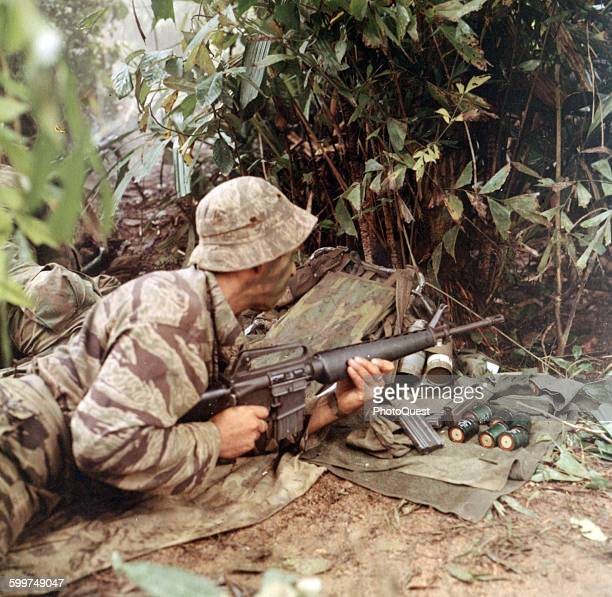 LRRP Sgt Curtis E Hester Asst Patrol Leader Co D 151st Inf opens fire with this M16 rifle against the enemy Viet Nam September 1 1969