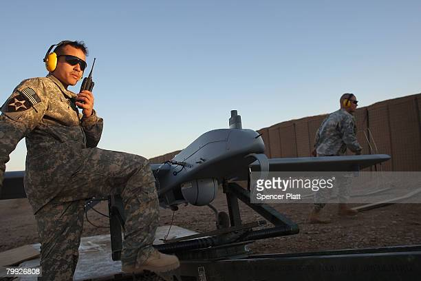 Sgt David Gomez of Brooklyn New York with US Army Delta Troop Task Force 21 Cavalry launches a Shadow unmanned aerial vehicle at Forward Operating...