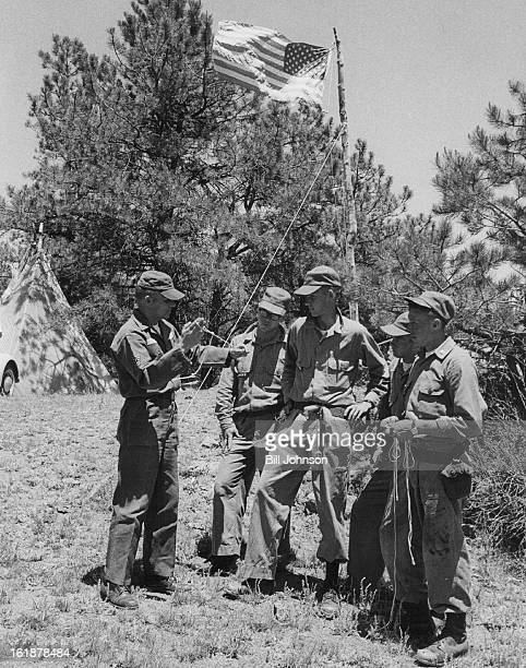 JUL 6 1965 JUL 7 1965 T Sgt Edwin Gowarski of Lowry Air Force Base shows a simple snare for trapping small game to ROTC Cadets The snare could...