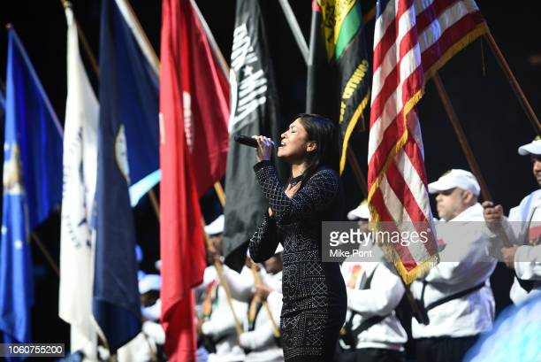 Sgt Elizabeth A Quinones performs on stage during Peace Starts With Me concert at Nassau Coliseum on November 12 2018 in Uniondale New York