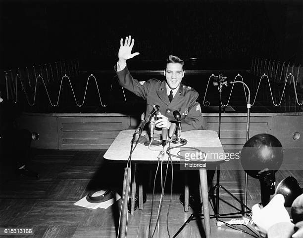 Sgt Elvis A Presley 32nd Armored 3d Armored Div giving his last press conference in Germany before returning to civilian life March 1 1960