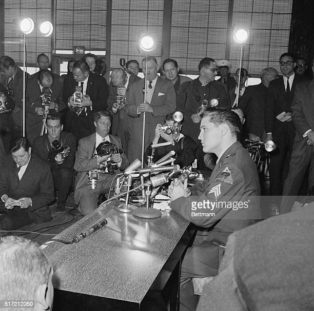 Sgt Elvis Presley faces a battery of photographers during his press conference here March 3rd following his arrival from Germany Presley is scheduled...