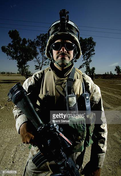 Sgt Fred Arencibia of 2nd Battalion First Marine Regiment Echo Company stands guard at a military base May 22 2004 outside of Fallujah Iraq