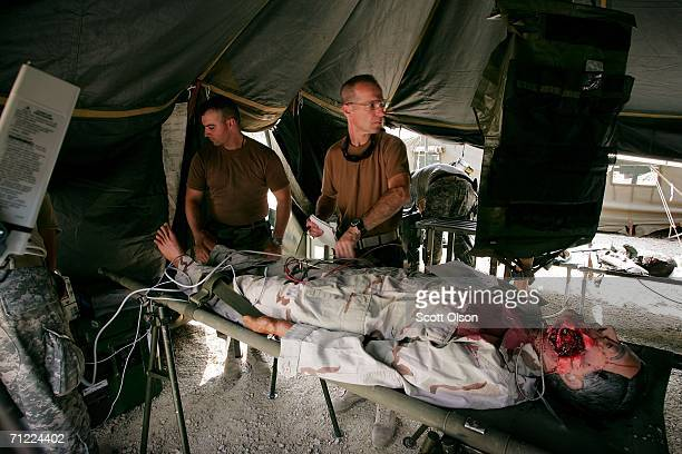 Sgt Jason Meeks of Belleview Florida and 1st Lt Lee Percy of Pensacola Florida work on a simulated casualty as they train with the 946th Forward...
