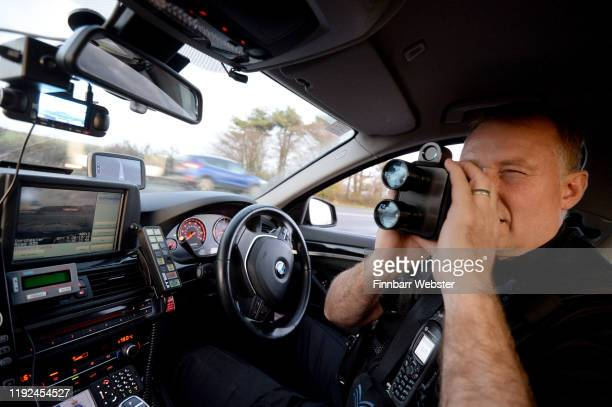 Sgt Jephcott from the No Excuse team uses a speed gun on the A35 as he patrols Dorset as part of the No Excuse campaign on December 06 2019 in...